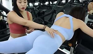 Two XXX Korean fitness models having fun working broadly