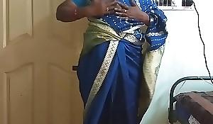 des indian horny cheating tamil telugu kannada malayalam hindi wife vanitha enervating blue colour saree  showing heavy boobs with the addition of shaved pussy press fixed boobs press nip rubbing pussy masturbation